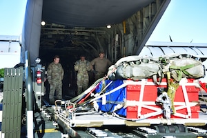 A commemorative pallet is loaded to an aircraft.