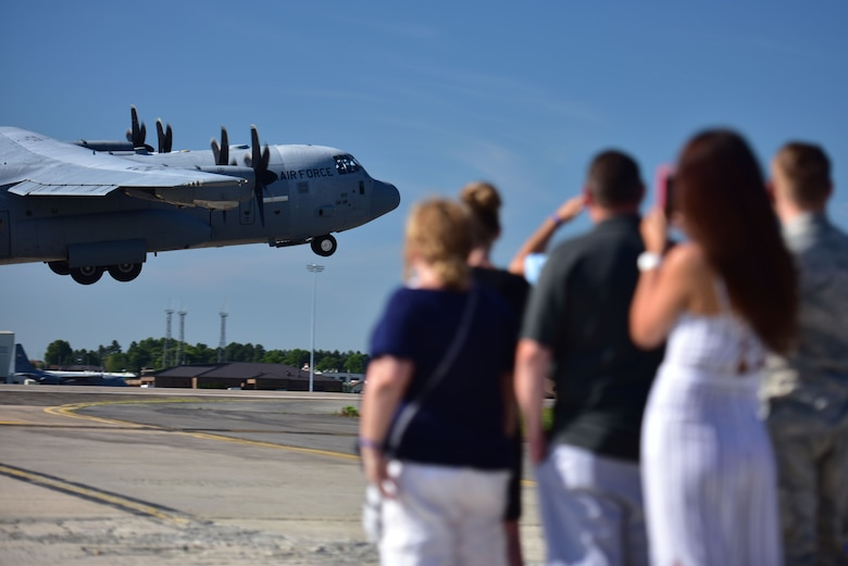 People watch an aircraft take off.
