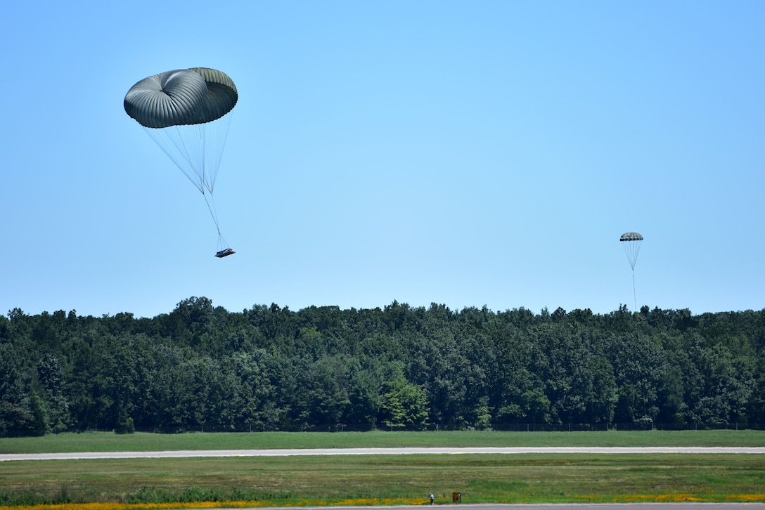 Two parachutes go to the ground.