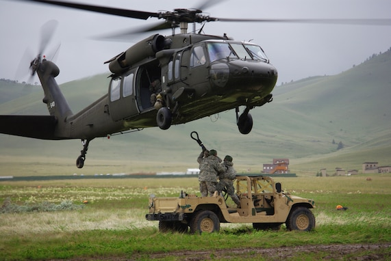 Soldiers with the 19th Special Forces and 2nd Battalion 211th Aviation Regiment conduct sling load operations during annual training at Camp Williams.