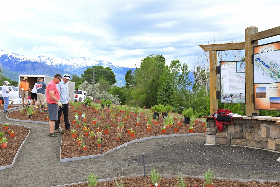 (left to right) Russ Lawrence, 75th Civil Engineering Group, and Nicholas R. Brown, liaison to Hill Air Force Base with U.S. Fish and Wildlife Service, discuss plant placement at the new pollinator garden plot, June 6, 2019, at Hill AFB, Utah. The garden will provide food and habitat for pollinator species such as hummingbirds, bees, and other insects, which are critical to maintaining diverse and healthy ecosystems. (U.S. Air Force photo by Todd Cromar)