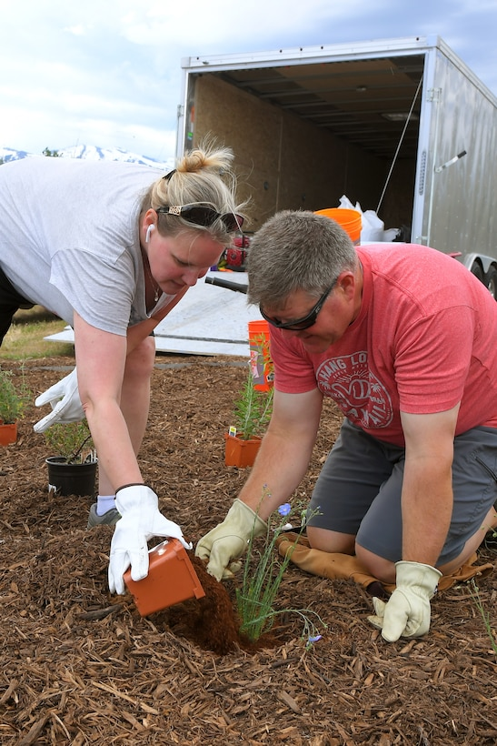 (left to right) Michelle Cottle and Russ Lawrence, both 75th Civil Engineering Group, plant vegetation at the new pollinator garden plot, June 6, 2019, at Hill Air Force Base, Utah. The garden will provide food and habitat for pollinator species such as hummingbirds, bees, and other insects, which are critical to maintaining diverse and healthy ecosystems. (U.S. Air Force photo by Todd Cromar)