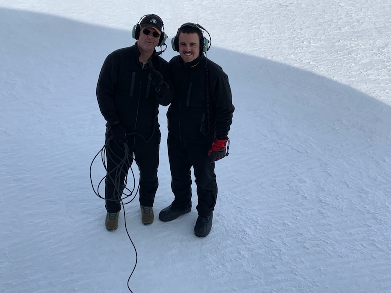 Chief Master Sgt. James Masura Jr., 313th Airlift Squadron loadmaster, and Senior Airman Chandler Smith, 313th AS loadmaster, pause for a photo while on an Operation Deep Freeze mission to the Antarctic. This mission was Masura's 100th, a record for C-17 Globemaster III supporting the U.S Antarctic Program's National Science Foundation research operations. (Courtesy photo)