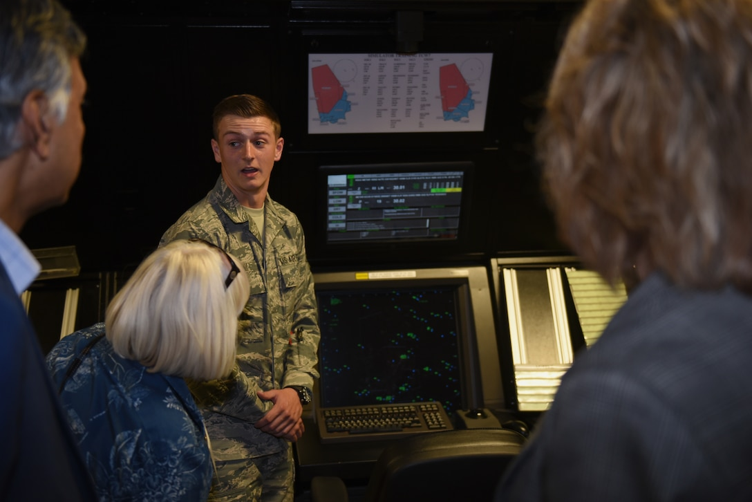 U.S. Air Force Airman 1st Class Jordan Hamlin, 60th Operations Support Squadron air traffic controller apprentice, explains how to read a radar to Honorary Commanders June 7, 2019, at Travis Air Force Base, California. The purpose of the Travis' Honorary Commander Program is to promote relationships between base senior leadership and civilian partners, foster civic appreciation of the Air Force mission and its Airmen, maximize opportunities to share the Air Force story with new stewards and to communicate mutual interest, challenges and concerns that senior leaders and civilian stakeholders have in common. (U.S. Air Force photo by Airman 1st Class Cameron Otte)