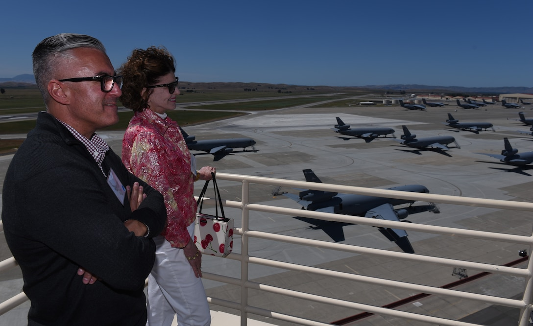 Honorary Commanders Mark Donaldson and Heidi Campini, see the flight line from the air traffic control tower June 7, 2019, at Travis Air Force Base, California. The purpose of the Travis' Honorary Commander Program is to promote relationships between base senior leadership and civilian partners, foster civic appreciation of the Air Force mission and its Airmen, maximize opportunities to share the Air Force story with new stewards and to communicate mutual interest, challenges and concerns that senior leaders and civilian stakeholders have in common. (U.S. Air Force photo by Airman 1st Class Cameron Otte)