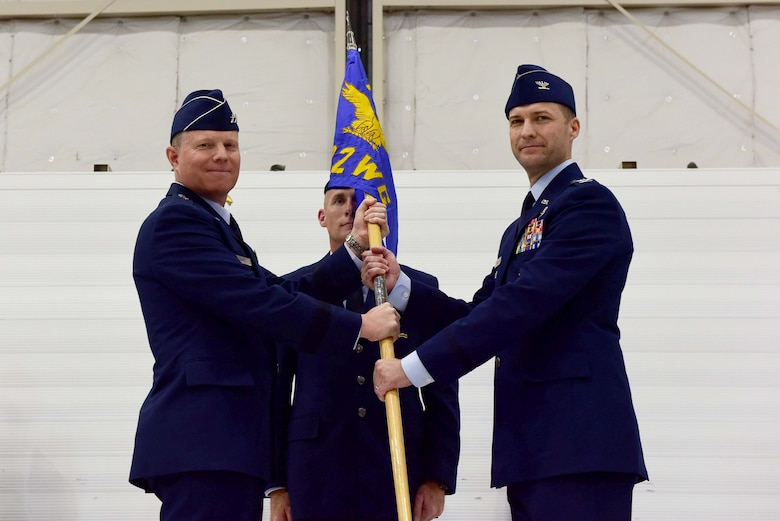Maj. Gen. Andrew Croft, Twelfth Air Force (Air Forces Southern) commander, presents the 432nd Wing/432nd Air Expeditionary Wing guideon to Col. Stephen Jones, incoming 432nd WG/432nd AEW commander, during the wing change of command ceremony at Creech Air Force Base, Nevada, June 7, 2019. Jones has previously been assigned to multiple squadrons at Creech, flown the B-1 Bomber, MQ-1 Predator and MQ-9 Reaper, and was an initial member of the team that armed the RQ-1 Predator. (U.S. Air Force photo by Airman 1st Class Haley Stevens)