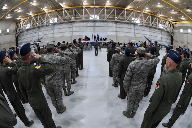 Col. Julian Cheater, outgoing 432nd Wing/432nd Air Expeditionary Wing commander, receives his final salute from Creech Airmen during the 432nd WG/432nd AEW change of command ceremony at Creech Air Force Base, Nevada, June 7, 2019. Cheater's advocacy resulted in the first-ever achievement decoration awarded to Remotely Piloted Aircraft aircrew for having direct and immediate impact on the battlefield, and he spearheaded efforts for a better quality of life for Creech Airmen, earning Cheater the Legion of Merit. (U.S. Air Force photo by Staff Sgt. James Thompson)