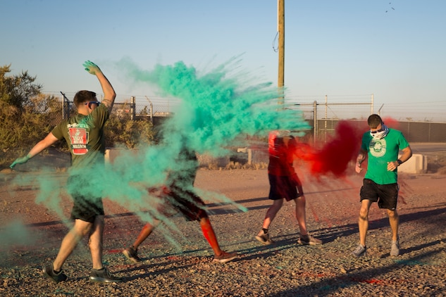 U.S. Marines stationed at Marine Corps Air Station (MCAS) Yuma take part in the Sexual Assault Prevention and Response color run on MCAS Yuma, Ariz., April 25, 2019. The 5 kilometer run took place in April, in order to support Sexual Assault Awareness Month. (U.S. Marine Corps photo by Pfc. John Hall)