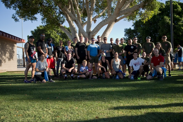 U.S. Marines Stationed at Marine Corps Air Station (MCAS) Yuma and their families pose for a photo after participating in the 2019 Environmental Earth Day Fun Run at MCAS Yuma Ariz., April 26, 2019. The Environmental Earth Day Fun Run is a 5k race held annually bringing awareness to Marines, Sailors, and civilians about the protection of our environment. (U.S. Marine Corps photo by Lance Cpl. Joel Soriano)