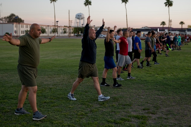 U.S. Marines Stationed at Marine Corps Air Station (MCAS) Yuma participate conduct warm up drills during High Intensity Tactical Training (HITT) on The Lawn at the parade deck on MCAS Yuma Ariz., April 26, 2019. HITT on the Lawn is a physical training event that is open to anyone with base access and provides them with a physical training opportunity. (U.S. Marine Corps photo by Lance Cpl. Joel Soriano)