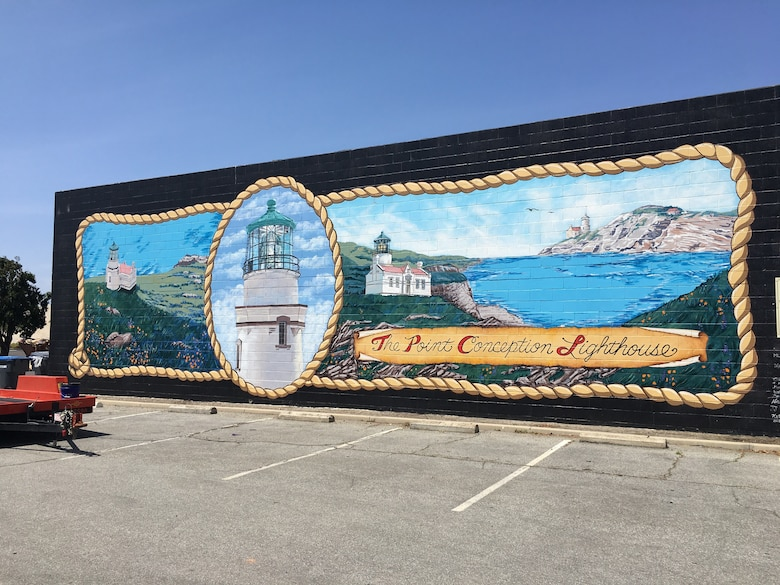 "The Point Conception Lighthouse mural highlights this lighthouse built in 1854, which for 165 years has guided mariners' navigation along the stretch of coast known as ""the graveyard of ships."""