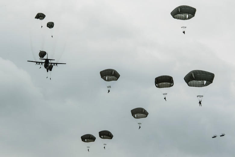 International Patatroopers participating in the D-Day Commemoration Airborne Operation fall into Iron Mike Drop Zone outside of Saint-Mere-Eglise, France June 9, 2019. Over 900 military paratroopers and 110 civilian parachutists from seven countries participated in the historic event. (U.S. Air Force photo by Senior Airman Devin M. Rumbaugh)
