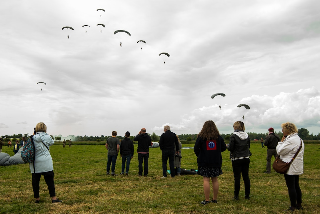 Military-free-fall parachutist prepare to land at Iron Mike Drop Zone outside of Sainte-Mère-Église, France June 9, 2019. The parachutists were from six European nations and members of the U.S. military. (U.S. Air Force photo by Senior Airman Devin M. Rumbaugh)