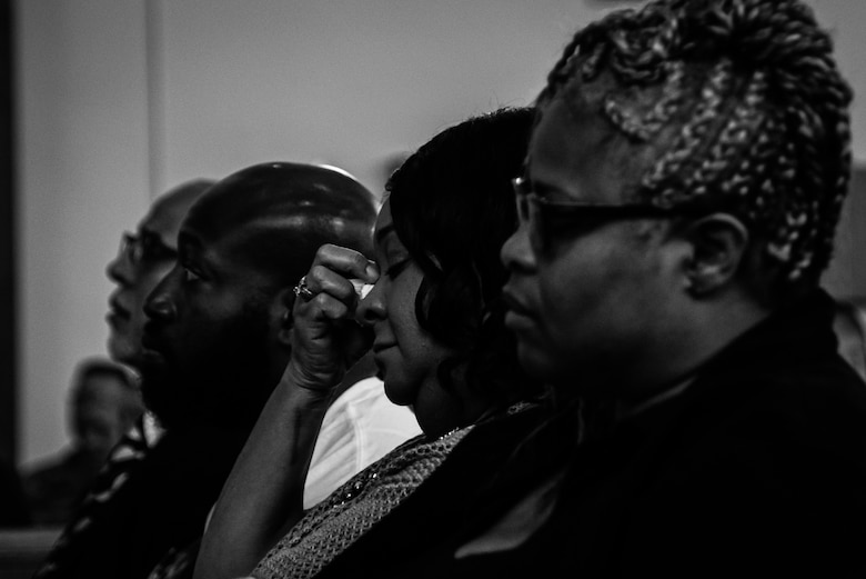 Family members of Senior Airman Aaron J. Hall, 20th Component Maintenance Squadron electronic warfare systems journeyman, sit during a memorial service at the Palmetto Chapel at Shaw Air Force Base, South Carolina, June 5, 2019.