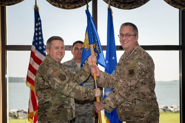 U.S. Air Force Col. Max Pearson, 480th Intelligence, Surveillance and Reconnaissance Wing commander, passes the guidon to Col. Scott Vickery, during a change of command ceremony at Joint Base Langley-Eustis, Virginia, June 6, 2019. Vickery assumed command of the 497th Intelligence, Surveillance and Reconnaissance Group and will direct the operations of seven squadrons in a Total Force environment, and lead more than 1,500 personnel. (U.S. Air Force photo by Senior Airman Nin Leclerec)