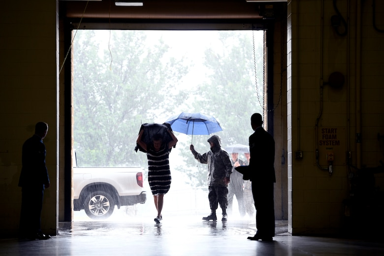 Torrential rain pours down as family members arrive for the Building Dedication Ceremony to honor four fallen Airmen, U.S. Air Force Lt. Col. Paul K. Mikeal, Maj. Joseph M. McCormick, Maj. Ryan S. David, and Senior Master Sgt. Robert S. Cannon, at the North Carolina Air National Guard Base, Charlotte Douglas International Airport, June 9, 2019. The four Airmen tragically lost their lives seven years ago in the Modular Airborne Fire Fighting System (MAFFS) seven accident while fighting fires in South Dakota. These Airmen were part of the MAFFS seven crew and are remembered with building dedication ceremonies to honor their legacy for years to come.
