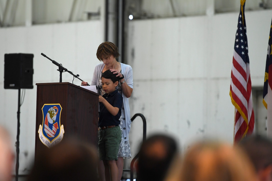 Rob David, son of fallen U.S. Air Force Maj. Ryan S. David, delivers a speech during the Building Dedication Ceremony in honor of his father and three other members of the Modular Airborne Fire Fighting System (MAFFS) seven crew at the North Carolina Air National Guard Base, Charlotte Douglas International Airport, June 9, 2019. The four Airmen tragically lost their lives seven years ago in the MAFFS seven accident while fighting fires in South Dakota. These Airmen are remembered with a building dedication ceremonies to honor their legacy for years to come.
