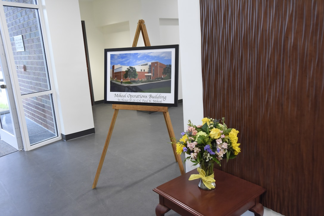 A commemorative picture is displayed during the dedication of the 145th Airlift Wing C-17 operations building to U.S. Air Force Lt. Col. Joseph Mikeal, at the North Carolina Air National Guard Base, Charlotte Douglas International Airport, June 9, 2019. Lt. Col. Mikeal tragically lost his life alongside 3 other C-130 crew members in the MAFFS 7 aircraft accident in 2012, the 145th Airlift Wing honored his and the other crew members sacrifice by naming four buildings across the wing after each one.
