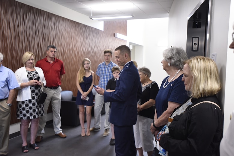 U.S. Air Force Lt. Col. James Pearson reads an emotional note to the family of Lt. Col. Joseph Mikeal, as they tour the 145th Airlift Wing's new state of the art operations building that now shares his name, at the North Carolina Air National Guard Base, Charlotte Douglas International Airport, June 9, 2019. Lt. Col. Mikeal tragically lost his life alongside 3 other C-130 crew members in the MAFFS 7 aircraft accident in 2012, the 145th Airlift Wing honored his and the other crew members sacrifice by naming four buildings across the wing after each one.
