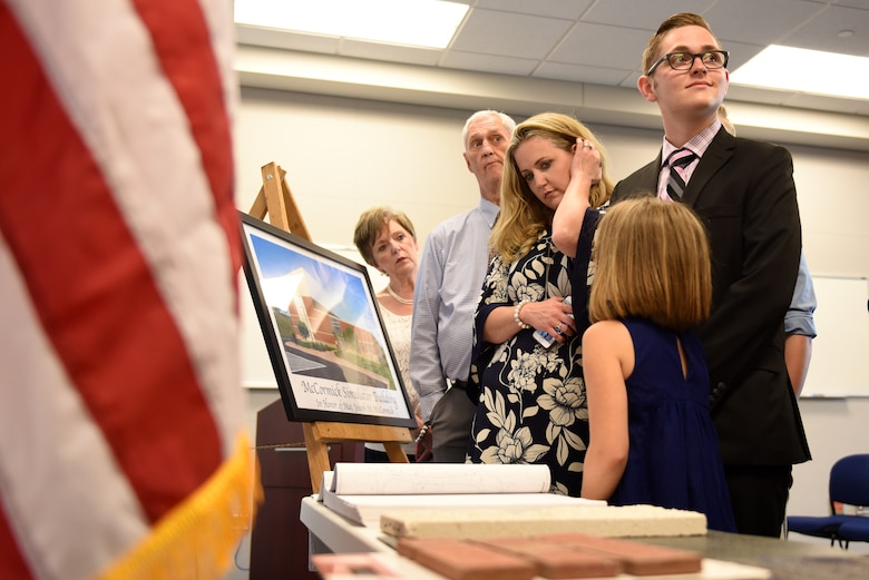 Family and friends of fallen U.S. Air Force Maj, Joseph M. McCormick view building plans and a dedication plaque at the North Carolina Air National Guard Base, Charlotte Douglas International Airport, June 9, 2019 following the Building Dedication Ceremony to honor Maj. McCormick and three other fallen Airmen, Lt. Col. Paul K. Mikeal, Maj. Ryan S. David, and Senior Master Sgt. Robert S. Cannon. The four Airmen tragically lost their lives seven years ago in the Modular Airborne Fire Fighting System (MAFFS) seven accident while fighting fires in South Dakota. These Airmen were part of the MAFFS seven crew and are remembered with building dedication ceremonies to honor their legacy for years to come.