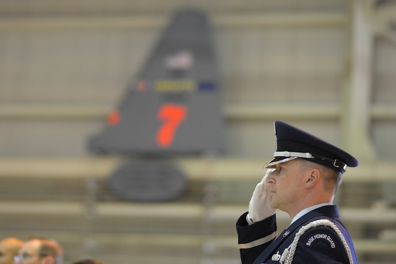 A member of the 145th Airlift Wing Honor Guard renders salute to the American Flag at the opening of the 145th Airlift Wing Building Dedication ceremony, at the North Carolina Air National Guard Base, Charlotte Douglas International Airport, June 9, 2019. The 145th Airlift Wing dedicated four buildings across the base to the fallen members of the MAFFS aircrew who passed away in 2012 following an accident while fighting a wild fire in South Dakota.