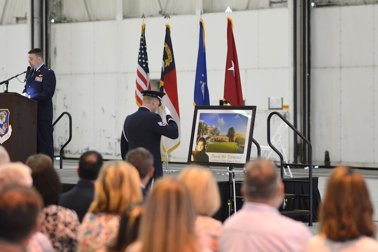 A member of the 145th Airlift Wing Honor Guard renders salute to a commemorative photo designed and printed in honor of U.S. Air Force Maj. Ryan S. David during the 145th Airlift Wing Building Dedication ceremony, at the North Carolina Air National Guard Base, Charlotte Douglas International Airport, June 9, 2019. The 145th Airlift Wing dedicated four buildings across the base to the fallen members of the MAFFS aircrew, including Maj. David, who passed away in 2012 following an accident while fighting a wild fire in South Dakota.