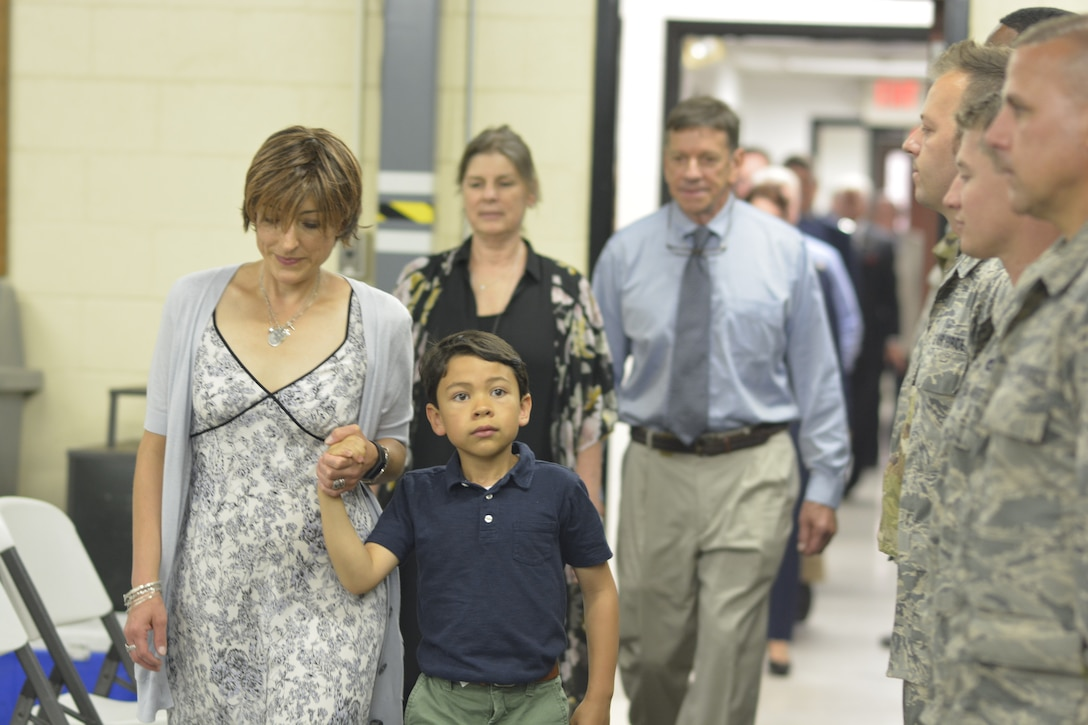 Members of the 145th Airlift Wing Small Air Terminal stand at attention for the family of U.S. Air Force Maj. Ryan S. David as they enter the building for the first time following it's dedication ceremony, at the North Carolina Air National Guard Base, Charlotte Douglas International Airport, June 9, 2019. The 145th Airlift Wing dedicated four buildings across the base to the fallen members of the MAFFS aircrew, including Maj. David, who passed away in 2012 following an accident while fighting a wild fire in South Dakota.