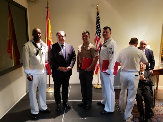 U.S. Marine Sgt. Jose Araya, an imagery analysis specialist, with Special Purpose Marine Air-Ground Task Force-Crisis Response-Africa 19.2, Marine Forces Europe and Africa, poses for a photo with Ambassador Duke Buchan III, United States Ambassador to Spain and Andorra, and other award recipients at the U.S. Embassy in Madrid, Spain, May 20, 2019.