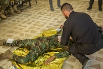Italian Carabinieri instructors lead Peshmerga soldiers through a first aid medical exercise at the Bnaslawa Training Center near Erbil, Iraq, on May 22, 2019.  The exercise concluded a two-week intermediate combat life saver course for 21 Peshmerga soldiers, run by the Carabinieri.  At the invitation of the Government of Iraq, members of the Global Coalition provide training and advice to local forces in support of the enduring mission to defeat Daesh. (U.S. Army photo by Spc. Kahlil Dash)