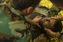 Peshmerga soldiers participate in a first aid medical exercise at the Bnaslawa Training Center near Erbil, Iraq, on May 22, 2019.  The exercise concluded a two-week intermediate combat life saver course for 21 participating Peshmerga soldiers under the direction of Italian Carabinieri instructors.  At the invitation of the Government of Iraq, members of the Global Coalition provide training and advice to local forces in support of the enduring mission to defeat Daesh. (U.S. Army photo by Spc. Kahlil Dash)