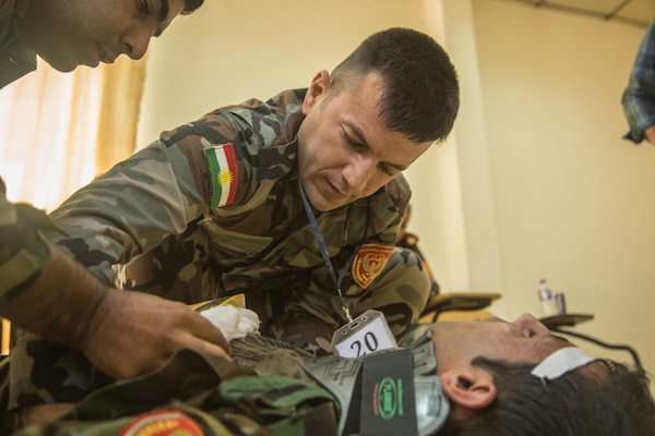 Peshmerga soldiers participate in a first aid medical exercise at the Bnaslawa Training Center near Erbil, Iraq, on May 22, 2019.  The exercise concluded a two-week intermediate combat life saver course for 21 Peshmerga soldiers under the direction of Italian Carabinieri instructors.  At the invitation of the Government of Iraq, members of the Global Coalition provide training and advice to local forces in support of the enduring mission to defeat Daesh. (U.S. Army photo by Spc. Kahlil Dash)