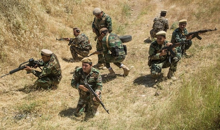 Peshmerga soldiers prepare to conduct a squad attack exercise at Bnaslawa Training Center near Erbil, Iraq, May 22, 2019.  The exercise was led by Peshmerga trainers under the guidance of Italian Army instructors.  The soldiers are among more than 500 Peshmerga soldiers participating in 10 weeks of training with the support of Coalition Forces.  At the invitation of the Government of Iraq, members of the Global Coalition provide training and advice to local forces in support of the enduring mission to defeat Daesh. (U.S. Army photo by Spc. Kahlil Dash)