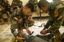 Peshmerga soldiers participate in a first aid medical exercise at the Bnaslawa Training Center near Erbil, Iraq, on May 22, 2019.  The exercise concluded a two-week intermediate combat life saver course for 21 Peshmerga soldiers, under the direction of Italian Carabinieri instructors.  At the invitation of the Government of Iraq, members of the Global Coalition provide training and advice to local forces in support of the enduring mission to defeat Daesh. (U.S. Army photo by Spc. Kahlil Dash)