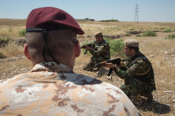 Peshmerga soldiers prepare to conduct a squad attack exercise at Bnaslawa Training Center near Erbil, Iraq, May 22, 2019, under the supervision of instructors from the Italian Army.  The soldiers are among more than 500 Peshmerga soldiers participating in 10 weeks of training with the support of Coalition Forces.  At the invitation of the Government of Iraq, members of the Global Coalition provide training and advice to local forces in support of the enduring mission to defeat Daesh. (U.S. Army photo by Spc. Kahlil Dash)