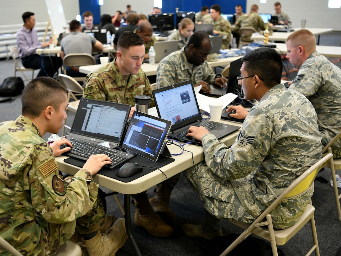 Teams compete in offensive and defensive cyber operations during the 2019 24th Air Force Cyber Competition in San Antonio, Texas, June 3-7, 2019. Eighty-three Airmen from 20 units across the 24th AF competed in the cyber capture-the-flag in hopes of having their names etched on the coveted cyber cup. (U.S. Air Force photo by Tech. Sgt. R.J. Biermann)