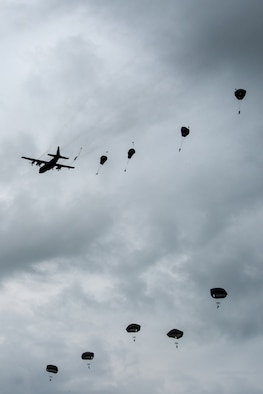 Paratroopers jump from a Kentucky Air National Guard C-130 Hercules over the Iron Mike drop zone in Sainte-Mère-Église, France, June 9, 2019, as part of the 75th-anniversary commemoration of D-Day. The Commemorative Airborne Operations event included nearly 1,000 paratroopers from Belgium, France, Germany, The Netherlands, Poland, Romania and the United Kingdom; and members of U.S. Special Operations Command Europe, United States Army Civil Affairs and Psychological Operations Command, 18th Airborne Corps, 75th Ranger Regiment, 82nd Airborne Division, 173rd Airborne Brigade, 503rd Military Police Battalion, 509th Infantry Regiment, 4th Brigade Combat Team (Airborne), 25th Infantry Division, and U.S. Air Forces Europe. D-Day remains a historic reminder of how the dedicated resolve of allies with a common purpose and shared vision builds proven partnerships that endure. (U.S. Air National Guard photo by Phil Speck)