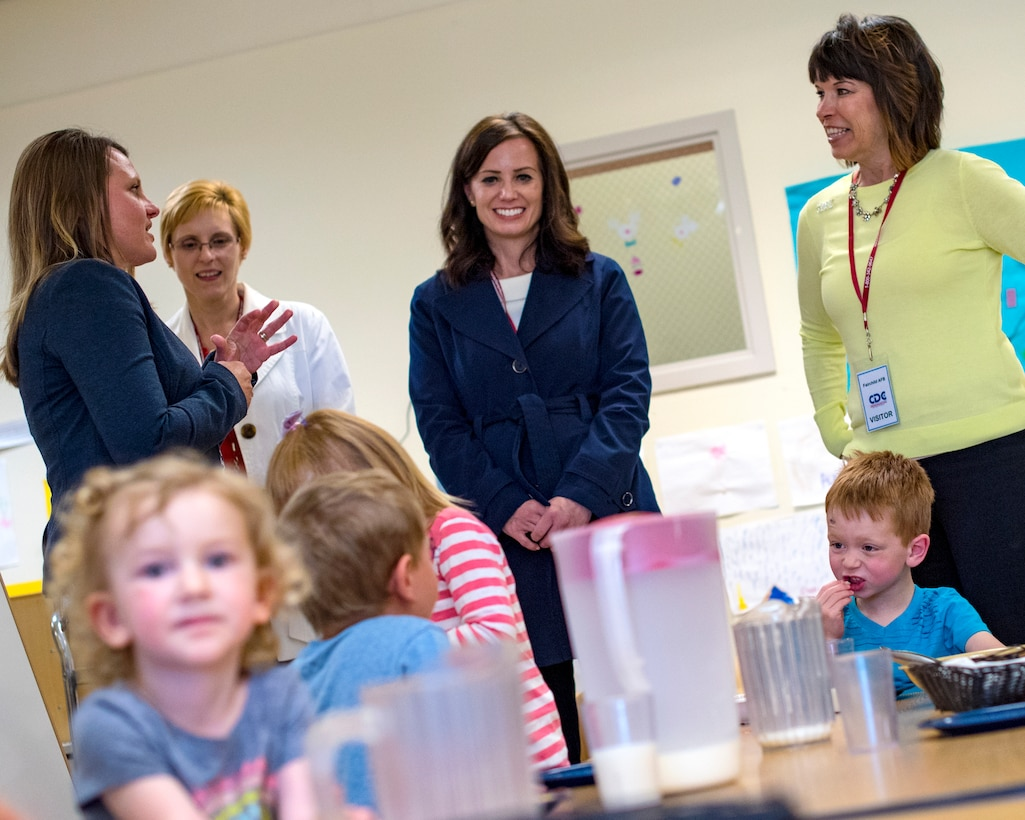 (From right to left) Kelly Barrett, 18th Air Force commander spouse, Kris Salmi, 92nd Air Refueling Wing commander spouse, and Mary Heathman, 92nd ARW vice commander spouse, visit with a Child Development Center class at Fairchild Air Force Base, Washington, May 21, 2019. Barrett toured the CDC and other family quality-of-life providers throughout her visit. (U.S. Air Force photo by Airman 1st Class Whitney Laine)
