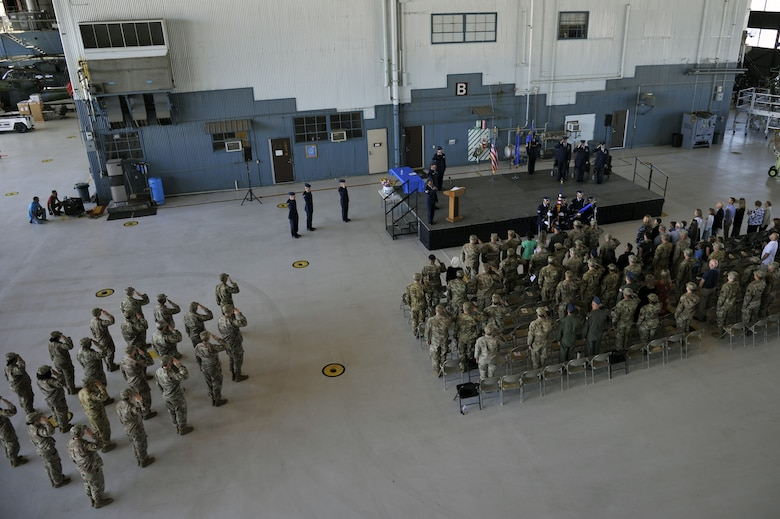 Members of the 58th Operations Support Squadron salute during the 58th OSS change of command ceremony at Kirtland Air Force Base, N.M., June 6, 2019. The mission of the 58th OSS is to provide training and support to tomorrow's special operations, personnel recovery, and homeland defense warriors. (U.S. Air Force photo by Staff Sgt. Dylan Nuckolls)