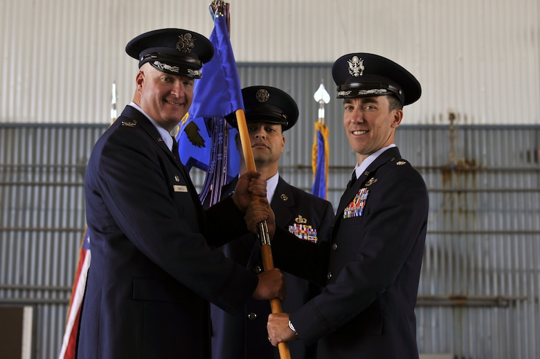 U.S. Air Force Lt. Col. Andrew Lazar (right), 58th Operations Support Squadron incoming commander, poses after he receives command of the 58th OSS from U.S. Air Force Col. Richard Carrell, 58th Operations Group commander, during the 58th OSS change of command ceremony at Kirtland Air Force Base, N.M., June 6, 2019. The mission of the 58th OSS is to provide training and support to tomorrow's special operations, personnel recovery, and homeland defense warriors. (U.S. Air Force photo by Staff Sgt. Dylan Nuckolls)