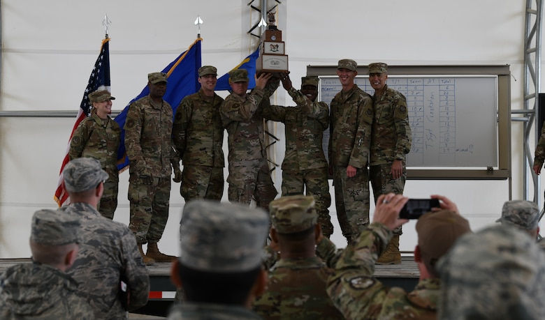 Vehicle operators from the 628th Logistics Readiness Squadron, hoist the 3rd Annual Ground Transportation Rodeo Trophy above their heads in triumph after winning the competition at Fort Leonard Wood, Mo., May 11, 2019.
