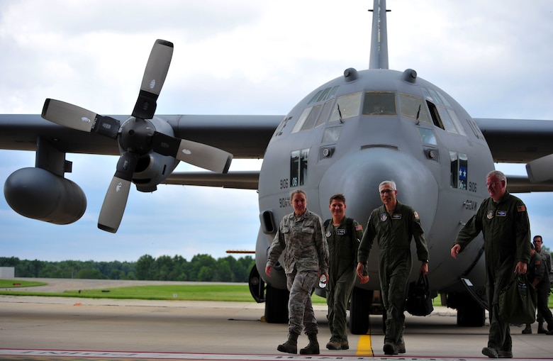 Maj. Gen. Craig L. La Fave, commander of the 22nd Air Force, disembarks a 910th Airlift Wing C-130H Hercules in front of a C-130 aircraft hangar on Youngstown Air Reserve Station after taking part in an aerial spray demonstration flight on June 2. La Fave visited YARS from June 1 through 3 making his way around the station and receiving briefings from several of the 910th AW's squadrons on how they provide a current, qualified, mission-ready force so the Air Force can fly, fight and win in air, space and cyberspace. (U.S. Air Force photo/Airman 1st Class Noah J. Tancer)