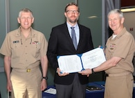 Vice Adm. Thomas Moore (right), commander, Naval Sea Systems Command, and Rear Adm. Lorin Selby, deputy commander for Ship Design, Integration and Engineering, present Michael Farrar, site director for Naval Surface Warfare Center, Carderock Division's South Florida Ocean Measurement Facility (Code 754), the Department of Navy Award for Technical Excellence at a Test and Evaluation Facility or Range during a ceremony at the Washington Navy Yard on May 29, 2019. (U.S. Navy photo by Laura Lakeway/Released)
