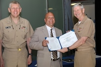 Vice Adm. Thomas Moore (right), commander, Naval Sea Systems Command, and Rear Adm. Lorin Selby, deputy commander for Ship Design, Integration and Engineering, present Timothy Cullis, an electrical engineer in Naval Surface Warfare Center, Carderock Division's Signatures Monitoring and Surface Ships Programs Branch, the Department of Navy Small Program Outstanding Tester Award during a ceremony at the Washington Navy Yard on May 29, 2019. (U.S. Navy photo by Laura Lakeway/Released)