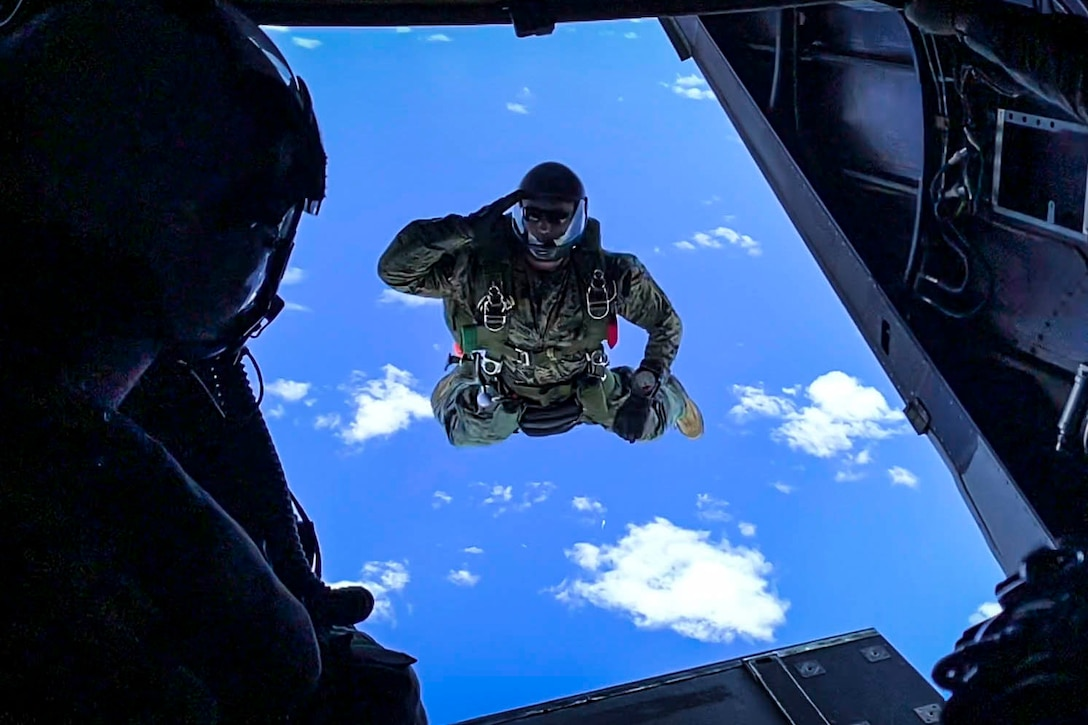 A Marine jumps from an aircraft.
