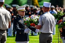 U.S. Marine Corps Col. George C. Schreffler III, commanding officer of 5th Marine Regiment, 1st Marine Division, receives a wreath during a ceremony at the Aisne-Marne Memorial near Belleau, France, May 26, 2019.