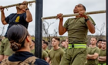 U.S. Marine Corps Cpl. Eddgar Cabrera, an assaultman with 11th Marine Regiment, 1st Marine Division, performs a pull-up for a physical fitness test, during a Command Sponsored Corporals Course (CSCC), at Marine Corps Base Camp Pendleton, California, June 3, 2019