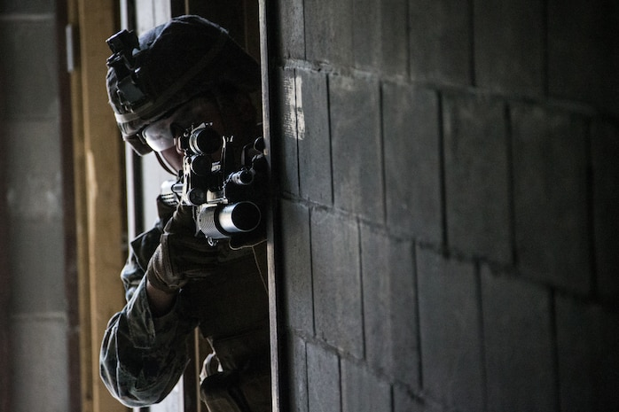 U.S. Marine Corps Cpl. Frederick C. Bailey III, a team leader with Echo Company, 2nd Battalion, 7th Marines, Special Purpose Marine Air Ground Task Force 7, sights in using a M4 carbine rifle, part of the units' squad competitions, during exercise Northern Edge (NE), May 22, 2019 at Fort Greely, Alaska.