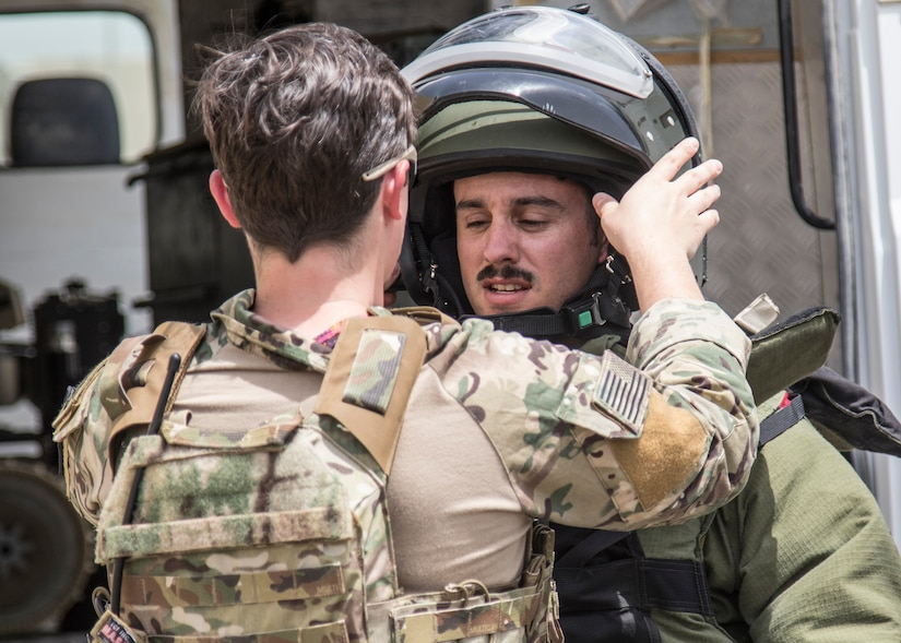A U.S. Army Soldier from the 744th Explosive Ordnance Disposal Company from Task Force Hellhound puts on his bomb suit on May 2, 2019 for a joint exercise with a simulated terrorist, explosive ordnance, and chemical situation at the Kuwait Special Forces Training Center. The exercise was crafted to build a shared understanding of Kuwait Civil Authorities and U.S. Forces procedures while reacting to any disaster, natural and manmade alike.