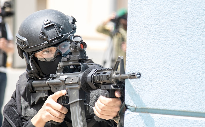 A member of the Kuwait Ministry of Interior's Special Weapons and Tactics team uses the corner of a building for cover while pulling security on May 2, 2019 during a joint exercise with a simulated terrorist, explosive ordnance, and chemical situation at the Kuwait Special Forces Training Center. The exercise was crafted to build a shared understanding of Kuwait Civil Authorities and U.S. Forces procedures while reacting to any disaster, natural and manmade alike.