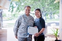 Col. Joyce Merl, 154th Mission Support Group commander, recognizes Airman Anuhea Pikake Alama, 154th Logistics Readiness Squadron materials handler, for her acceptance into the Air Force Academy Preparatory School June 2, 2019, at Joint Base Pearl Harbor-Hickam, Hawaii.